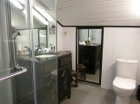 The roof accounts for the sloping ceiling of the Loft's gorgeously appointed bathroom.