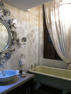 The boudoir-style bathroom of the Opium room.