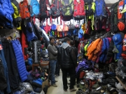 Our first friend in Nepal, Pradeep helps Khairul pick out a hiking pole from a nearby outdoor gear store. Packed from floor to ceiling with all your adventure needs, you can find brand name and knock off sleeping bags, backpacks, jackets, hiking poles, you name it....
