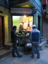 Within a small muslim enclave a butcher sells halal meat.