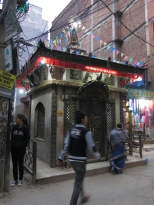 The sounds of a bell occasionally rings from a street side temple.