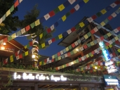 Buddhist prayer flags decorate the streets.