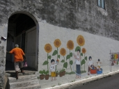 Street art decorates some of the back lanes in KKB.