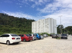 The top of Jalan Taman Saga. These flats will be on your right, Bukit Saga directly ahead of you and the path towards the trailhead to your left.